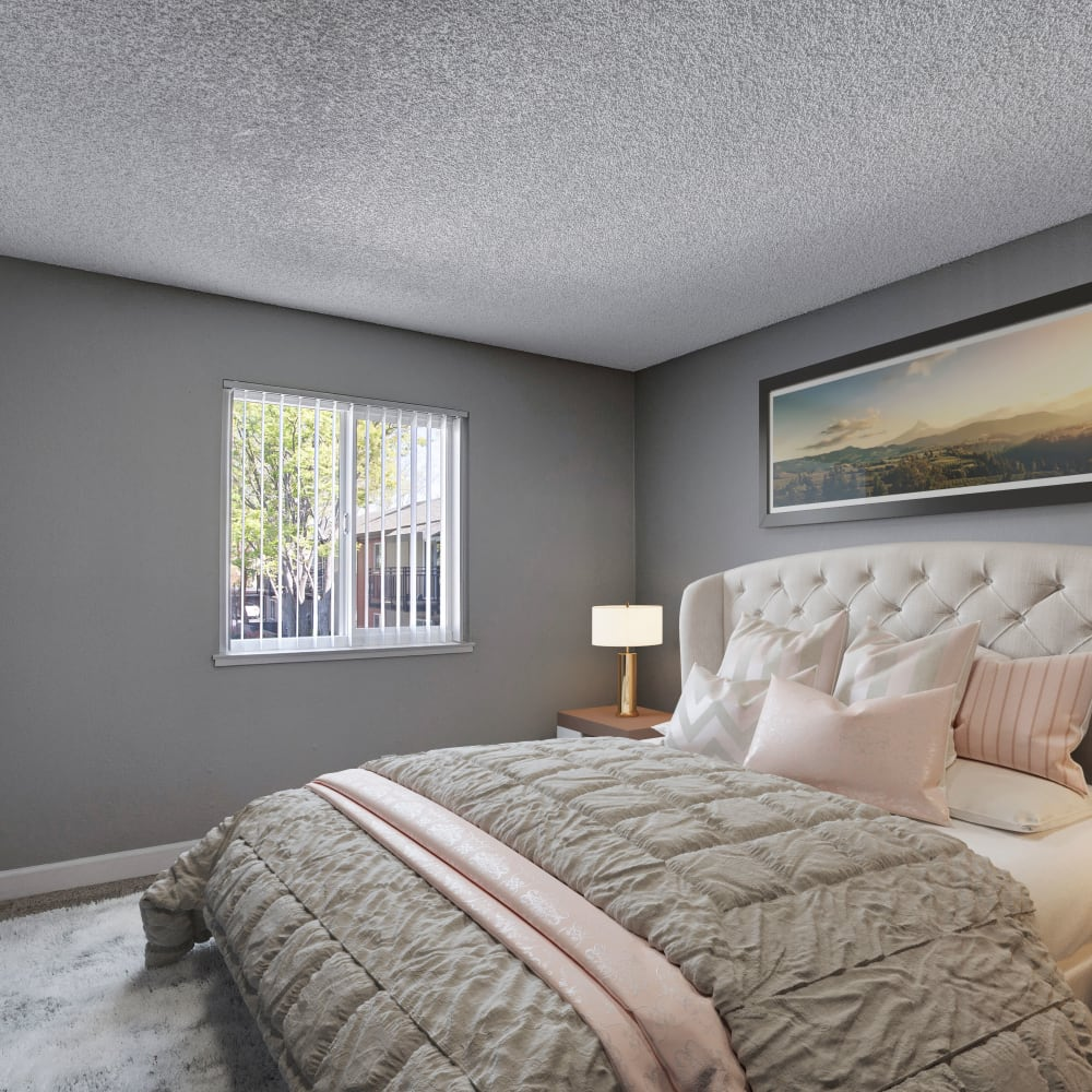 Bedroom with large window at The Archer in Sacramento, California