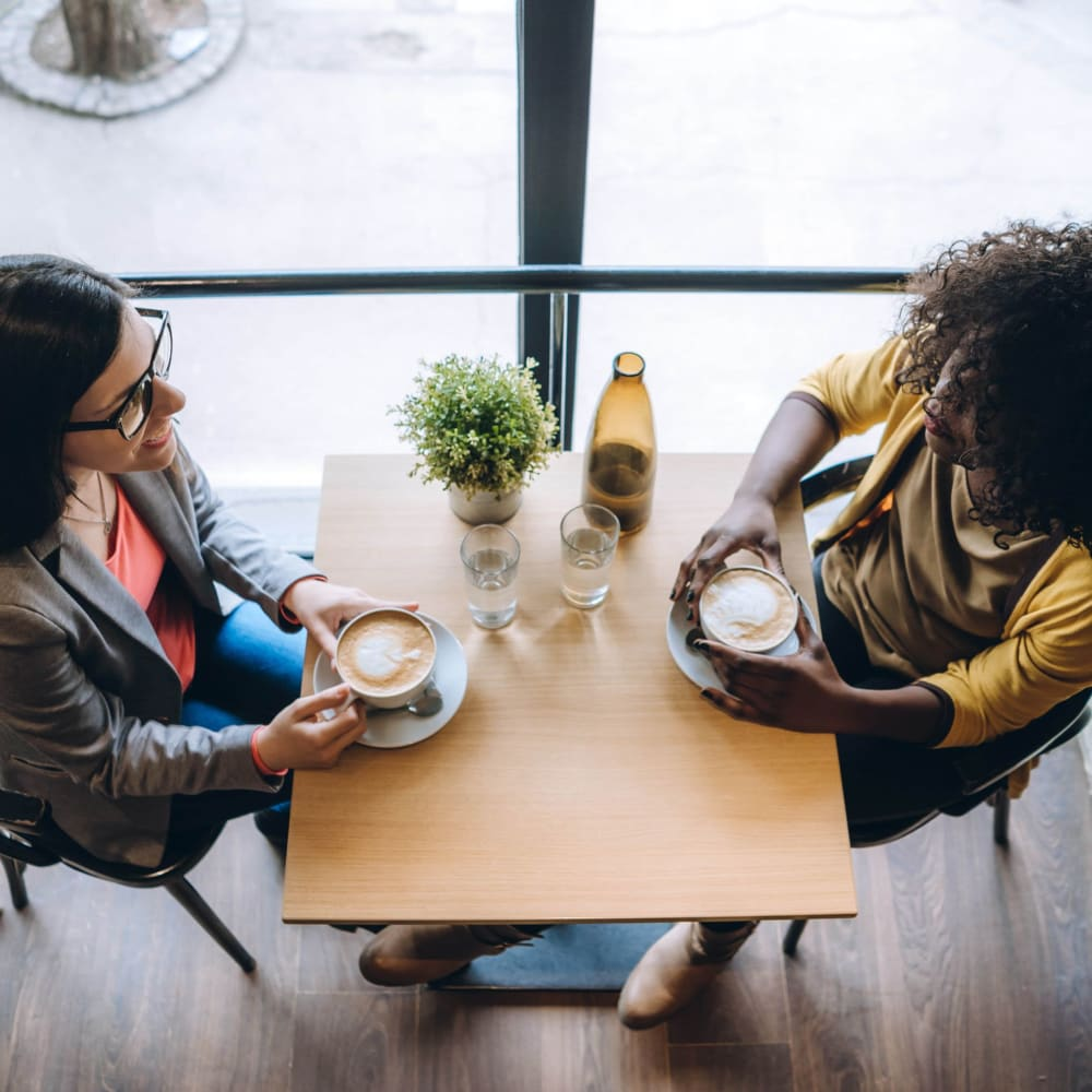 Couple chatting over coffee near Optimist Lofts in Atlanta, Georgia