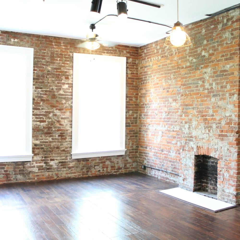 Well-lit floor plan with fireplace at The Maven @ 806 in Louisville, Kentucky