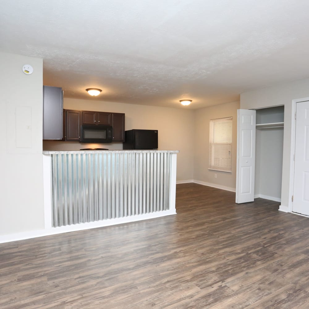 Kitchen and living room at Clifton Ridge Apartments in Louisville, Kentucky