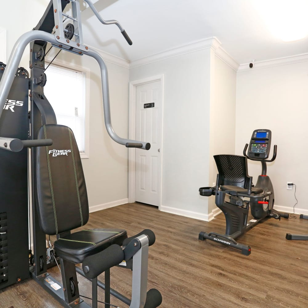 Weight machines in gym at Rippling Stream Townhomes in Durham, North Carolina
