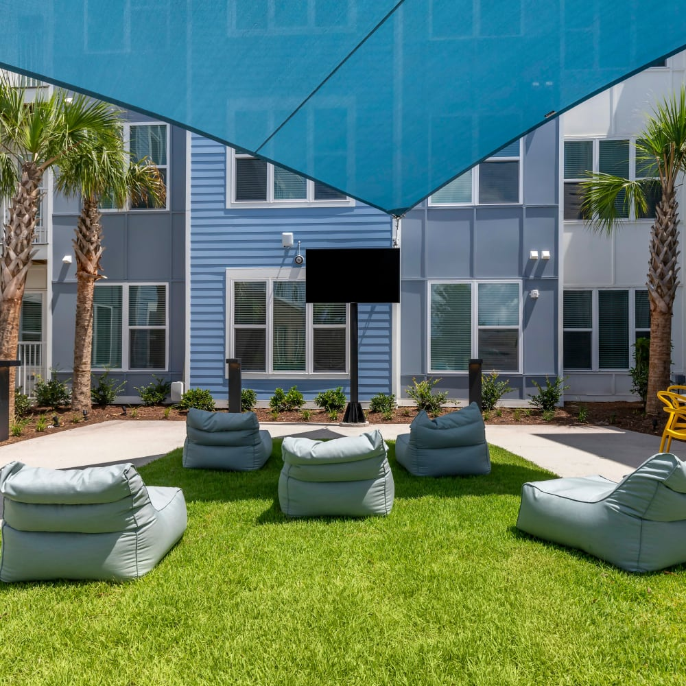 Courtyard with games for residents at UNCOMMON Wilmington in Wilmington, North Carolina