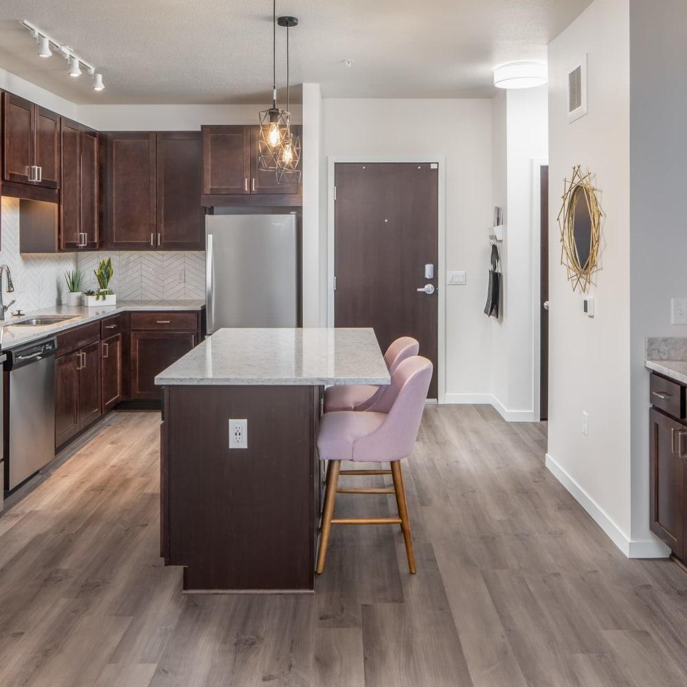 Spacious kitchen with granite counters at Oaks Minnehaha Longfellow in Minneapolis, Minnesota