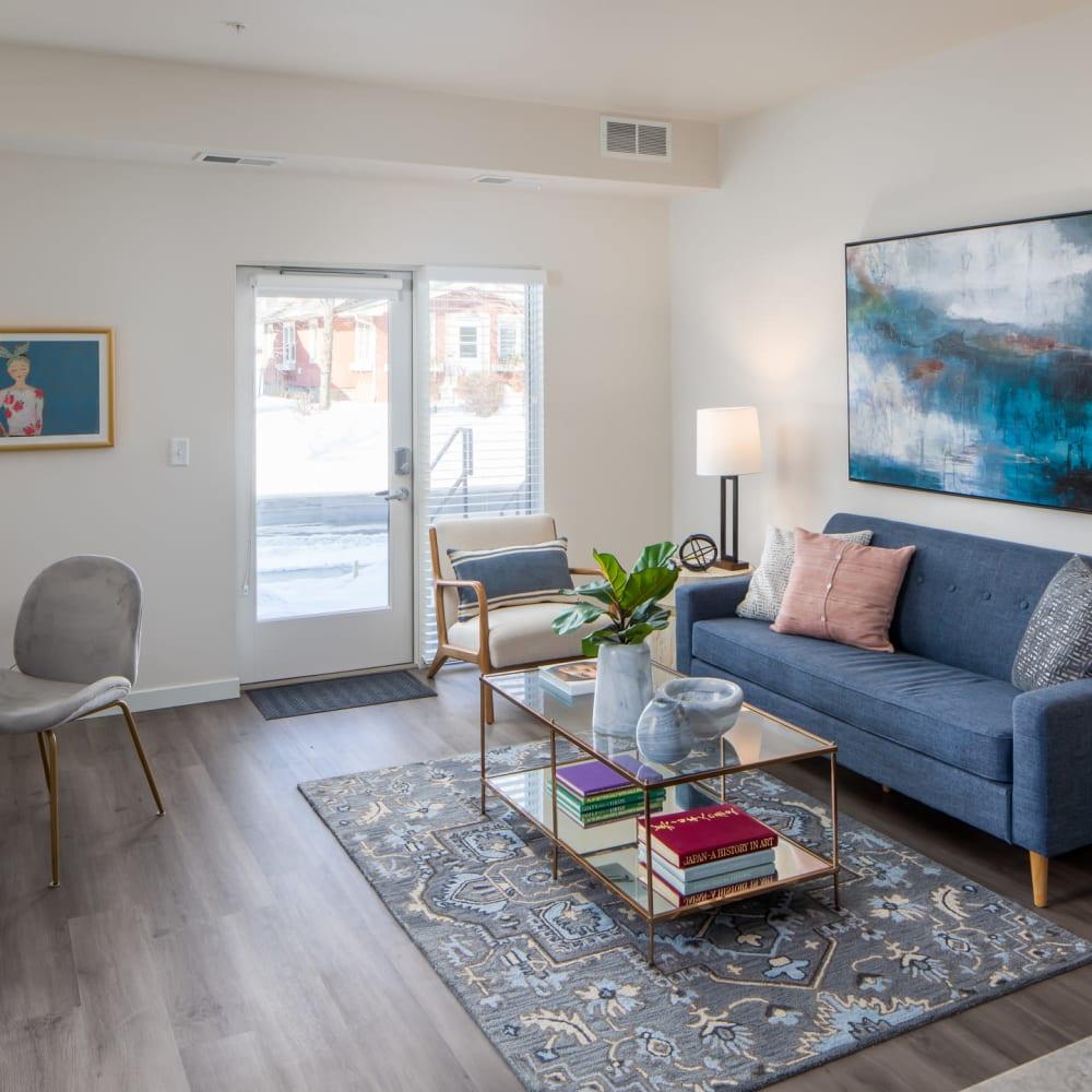 Living room with wood style flooring at Oaks Minnehaha Longfellow in Minneapolis, Minnesota