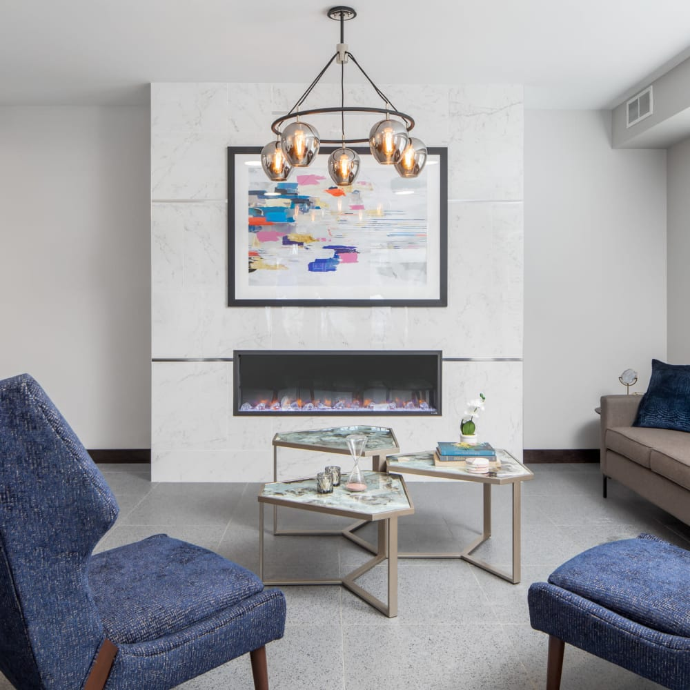 Bright living room with a fireplace at Oaks Minnehaha Longfellow in Minneapolis, Minnesota