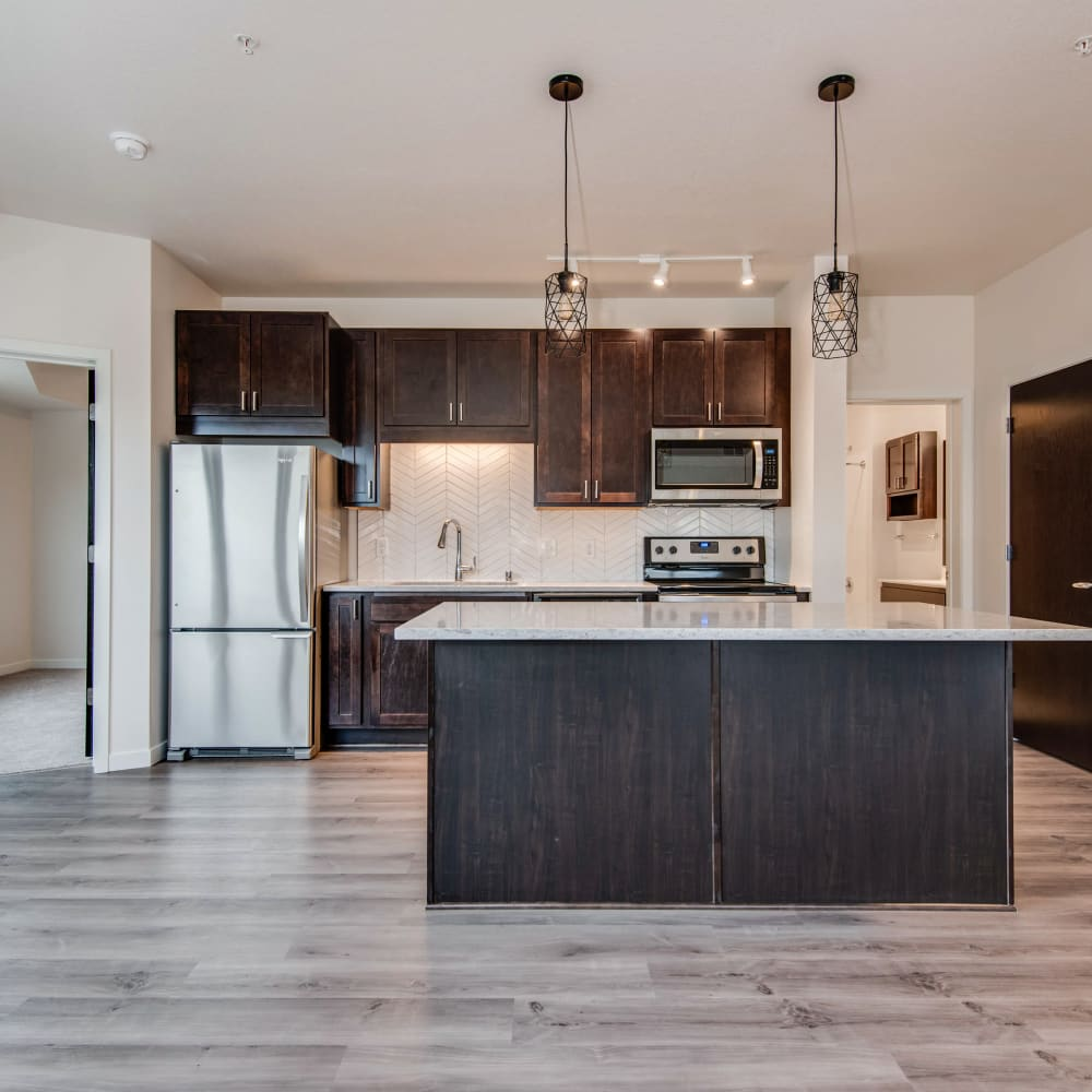 Kitchen with an island and granite counters at Oaks Minnehaha Longfellow in Minneapolis, Minnesota