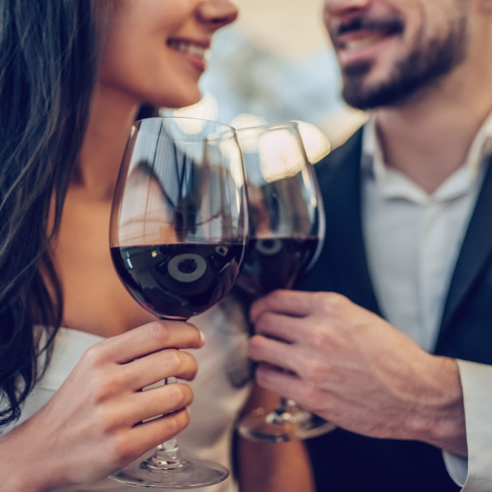 A couple enjoying red wine together at a restaurant in Austin, Texas