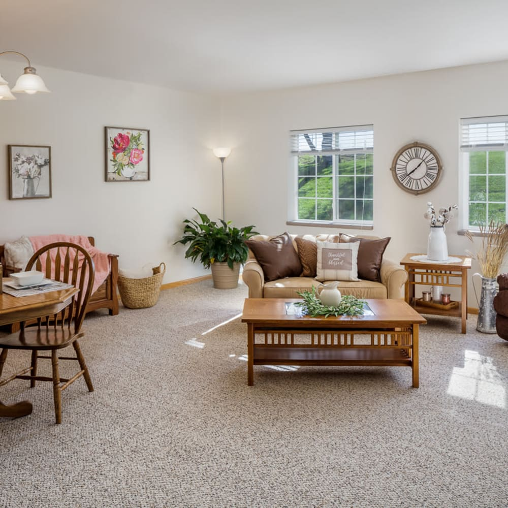 Living room with windows at Glenwood Place in Marshalltown, Iowa.