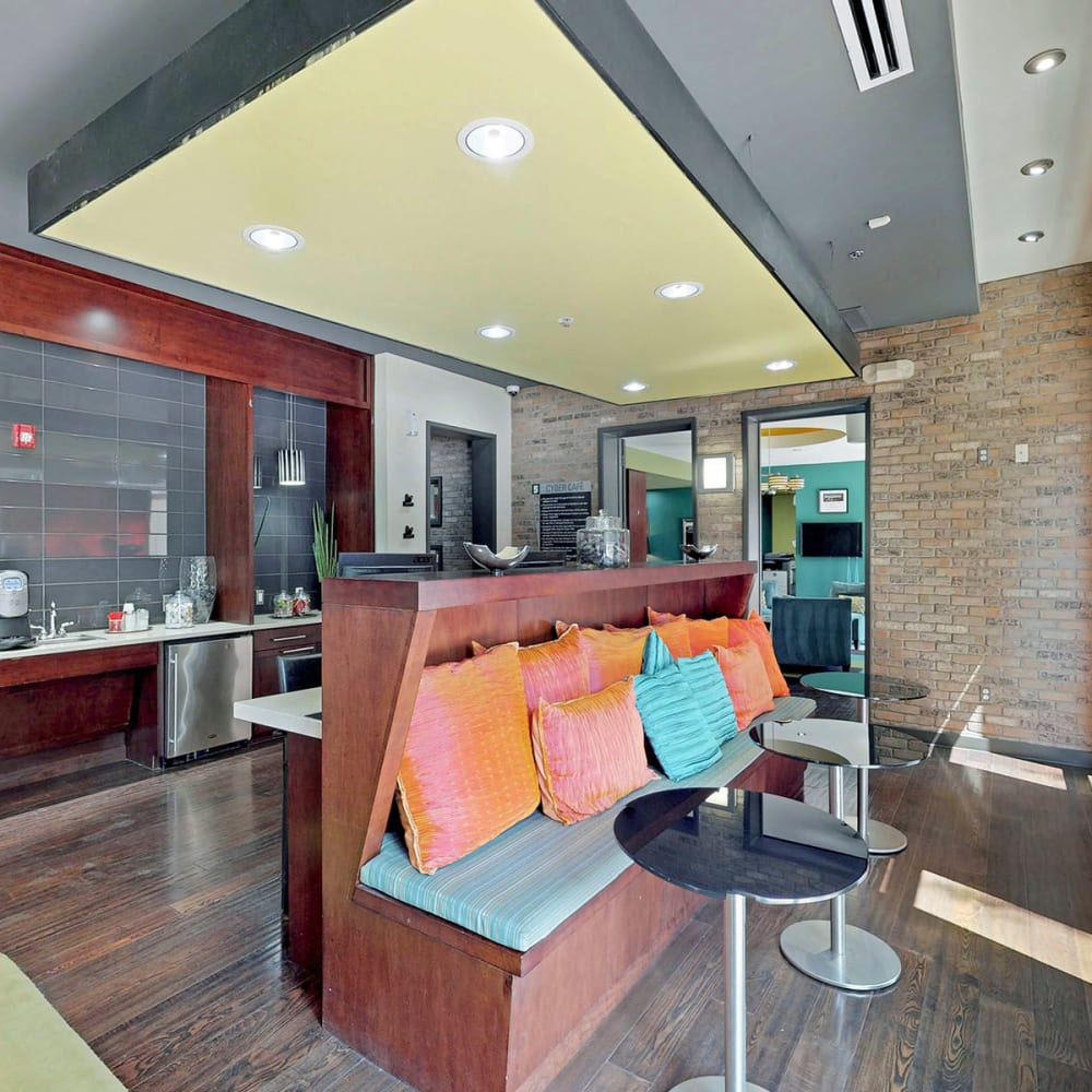 Comfortable places to relax in the lobby at Oaks 5th Street Crossing at City Station in Garland, Texas