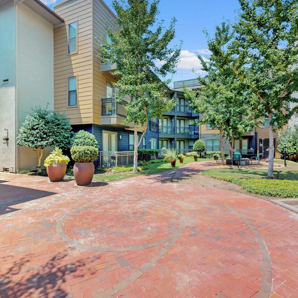 Courtyard between resident buildings at Oaks 5th Street Crossing at City Station in Garland, Texas