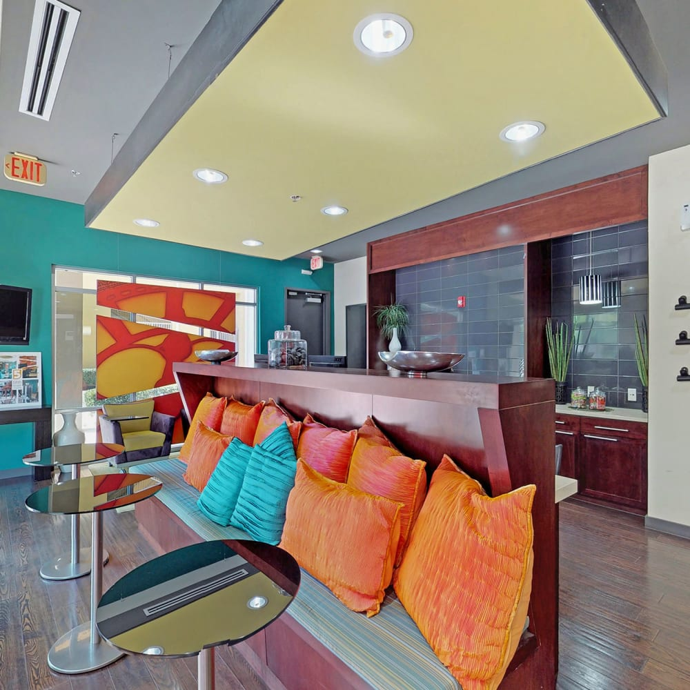 Colorfully decorated lobby at Oaks 5th Street Crossing at City Station in Garland, Texas