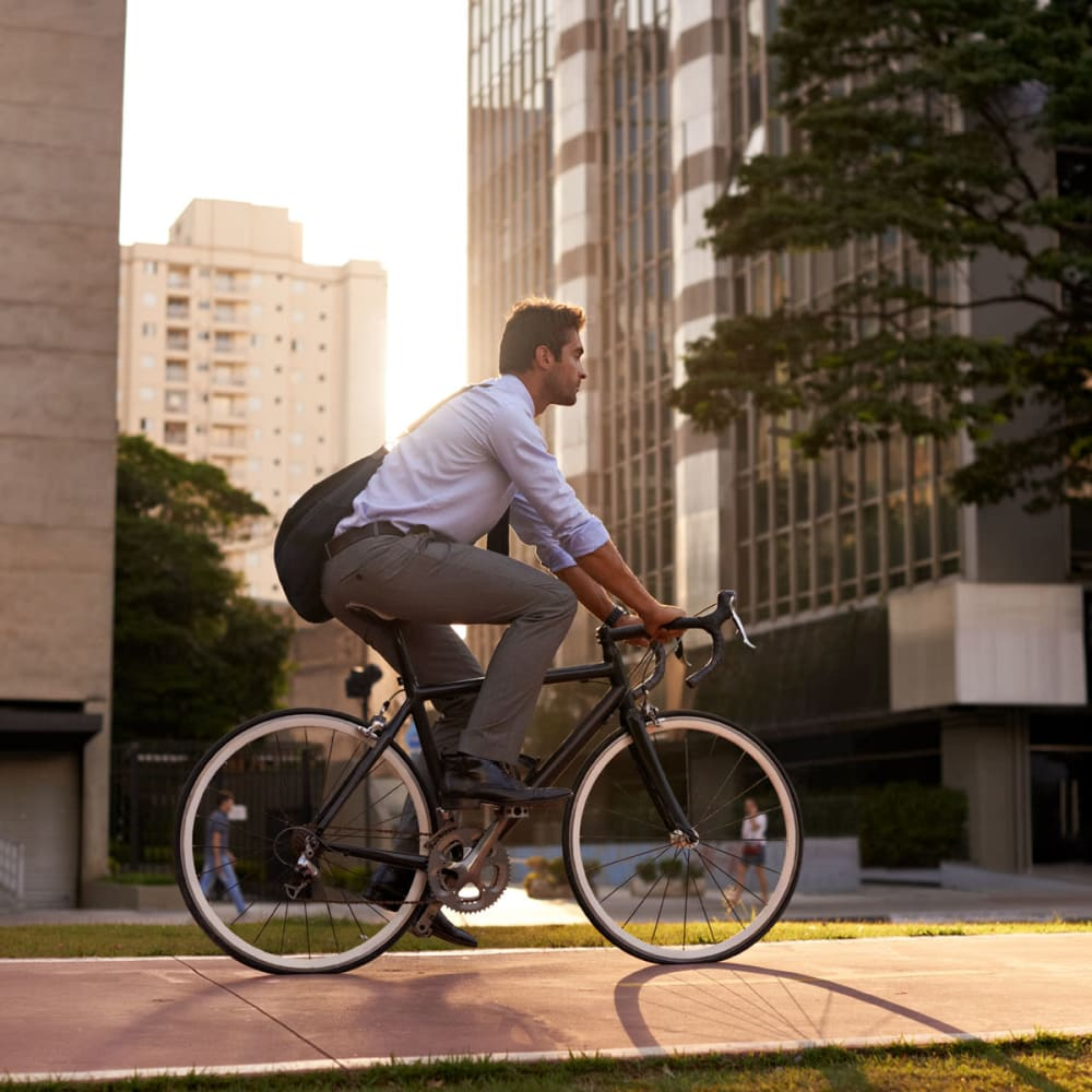 Resident biking to work downtown near Oaks 5th Street Crossing City Center in Garland, Texas