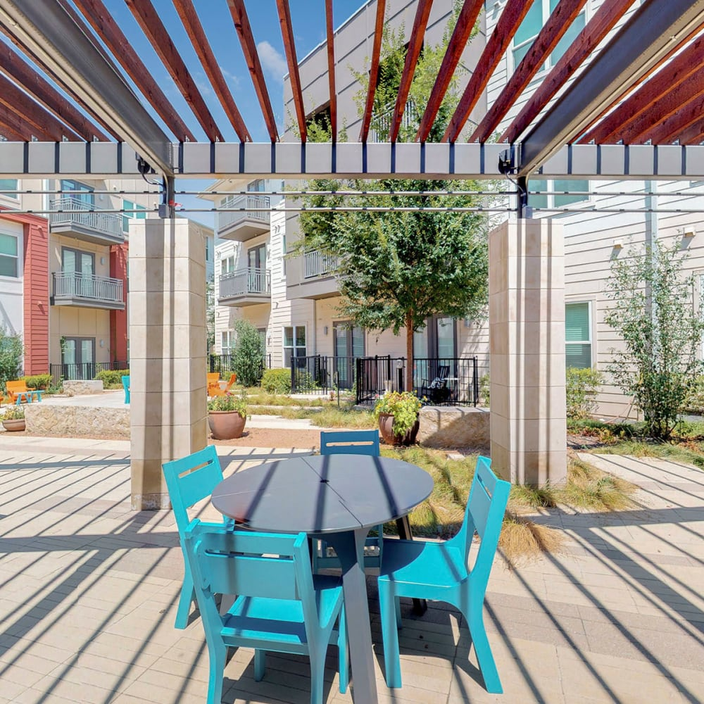 Pergola above one of the outdoor seating areas at Oaks 5th Street Crossing City Center in Garland, Texas