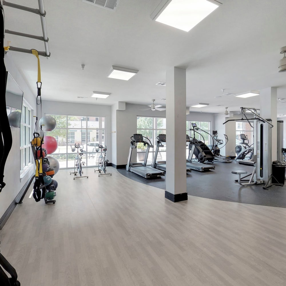 Spacious and well-equipped fitness center at Oaks 5th Street Crossing City Center in Garland, Texas