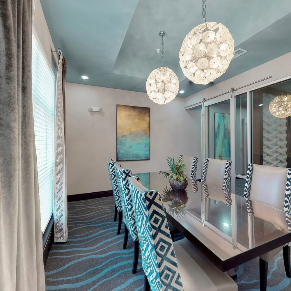 Business center with conference rooms for resident use at Oaks 5th Street Crossing City Center in Garland, Texas