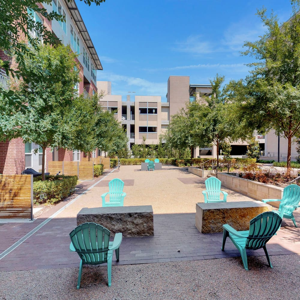 Adirondack chairs at one of the exterior courtyards at Oaks 5th Street Crossing City Center in Garland, Texas