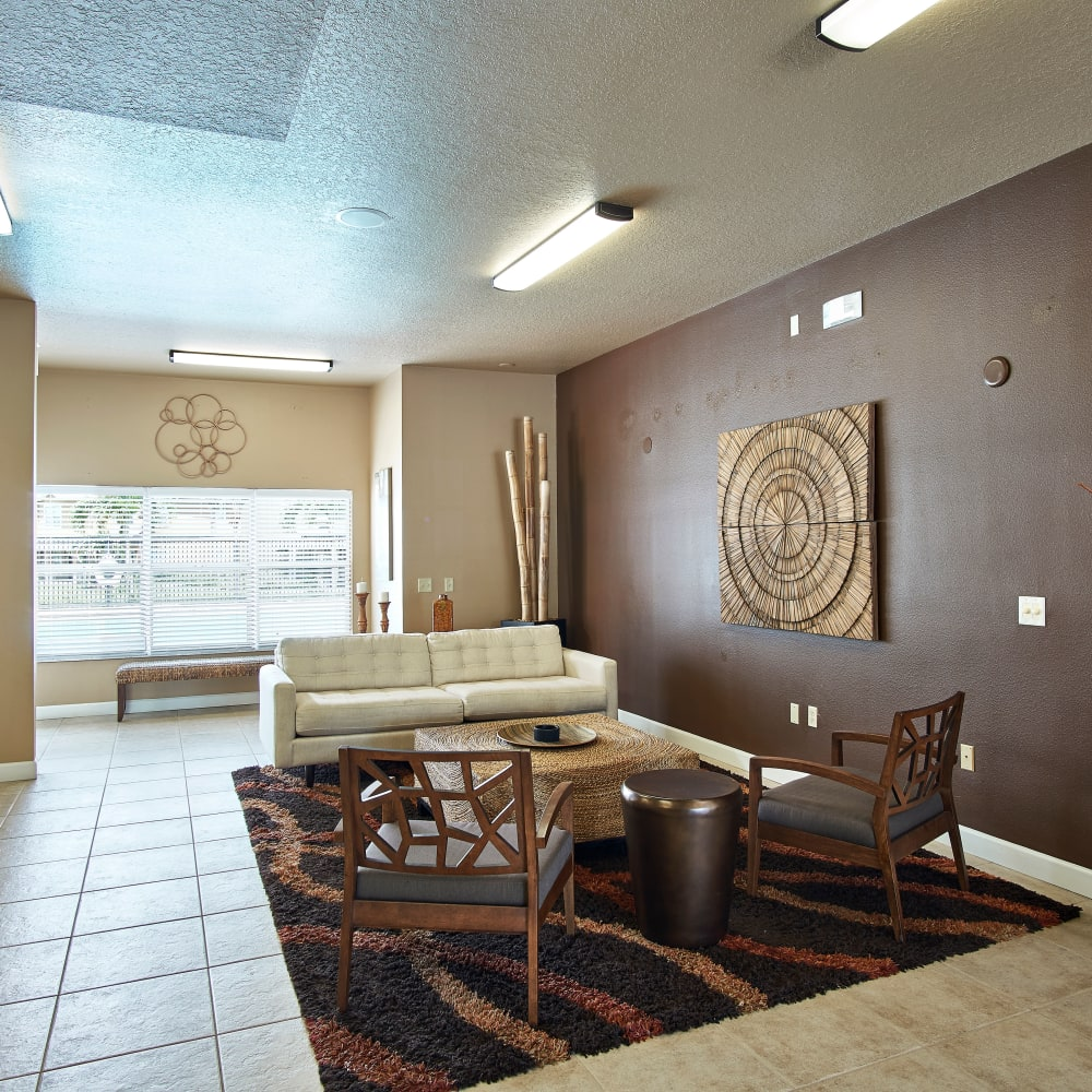 A clubhouse with plenty of seating at Calais Park Apartments in St Petersburg, Florida
