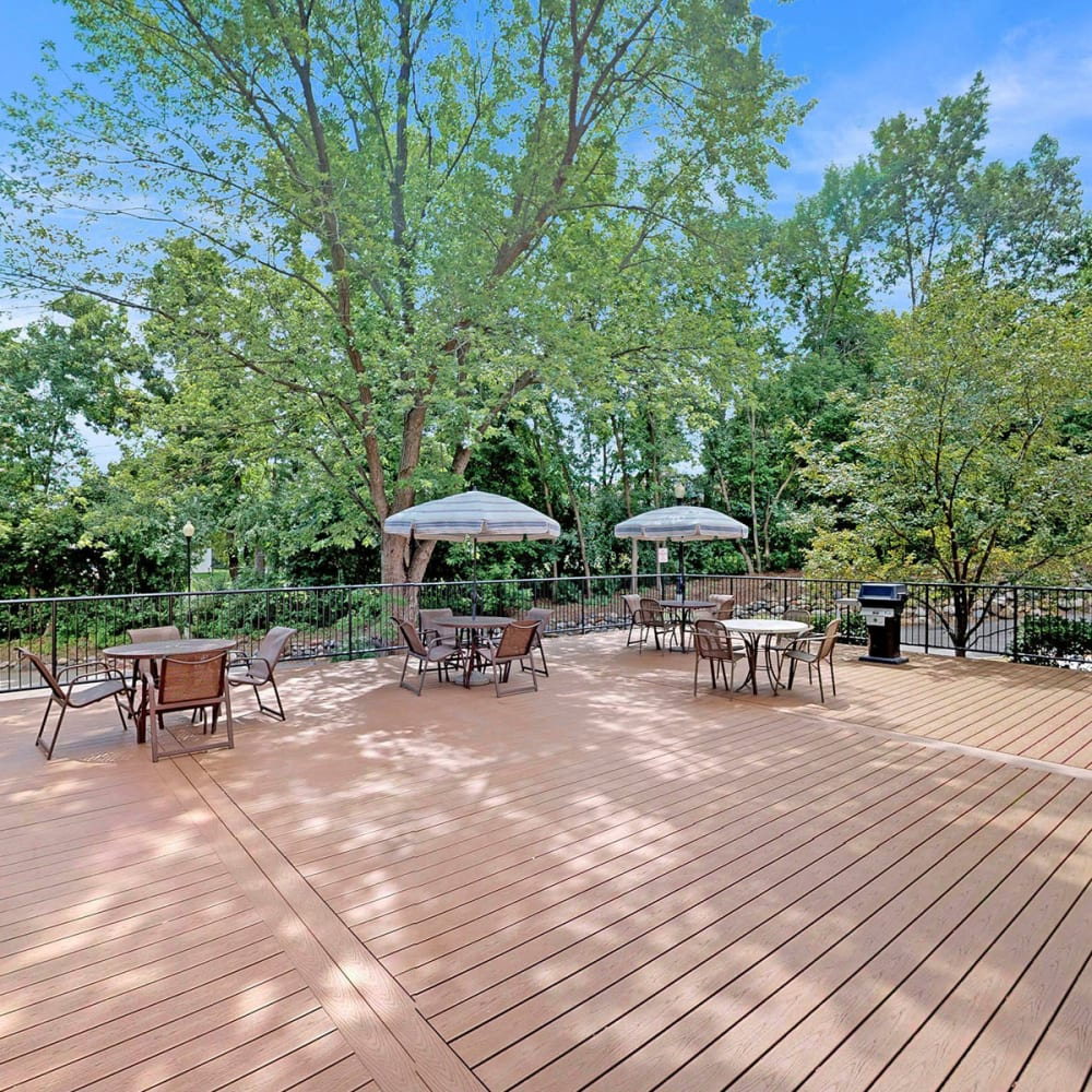 Expansive deck with shaded seating areas at Oaks Braemar in Edina, Minnesota