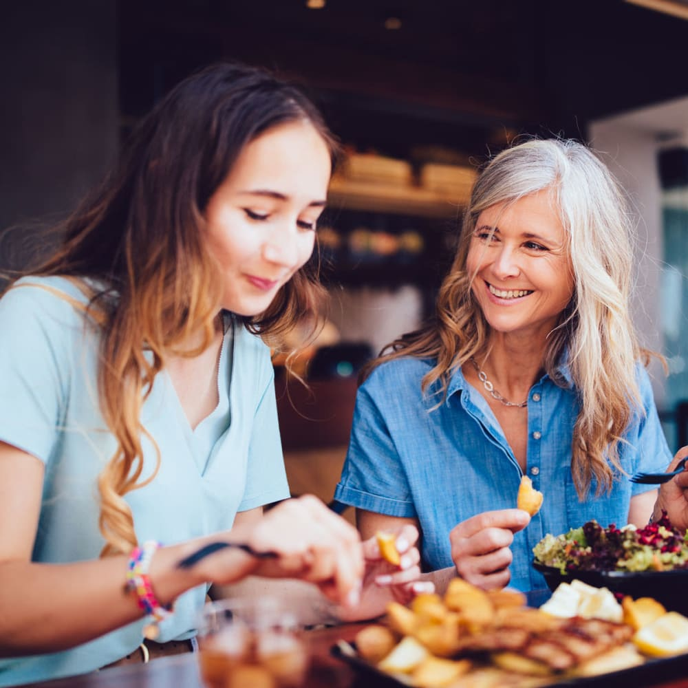 Mother and daughter enjoying a meal and some laughs at their favorite spot near Oaks Hackberry Creek in Irving, Texas