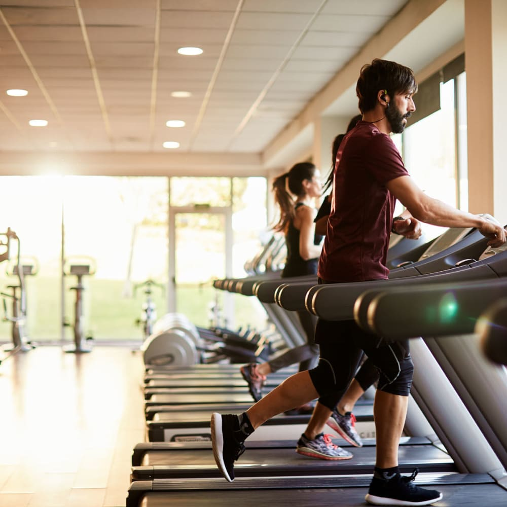 Residents staying in shape in the fitness center at Oaks Hackberry Creek in Irving, Texas