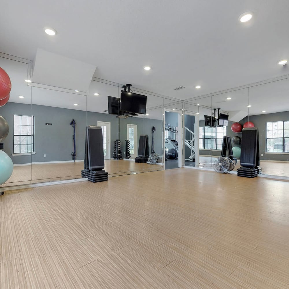 Spacious yoga area in the fitness center at Oaks Hackberry Creek in Las Colinas, Texas