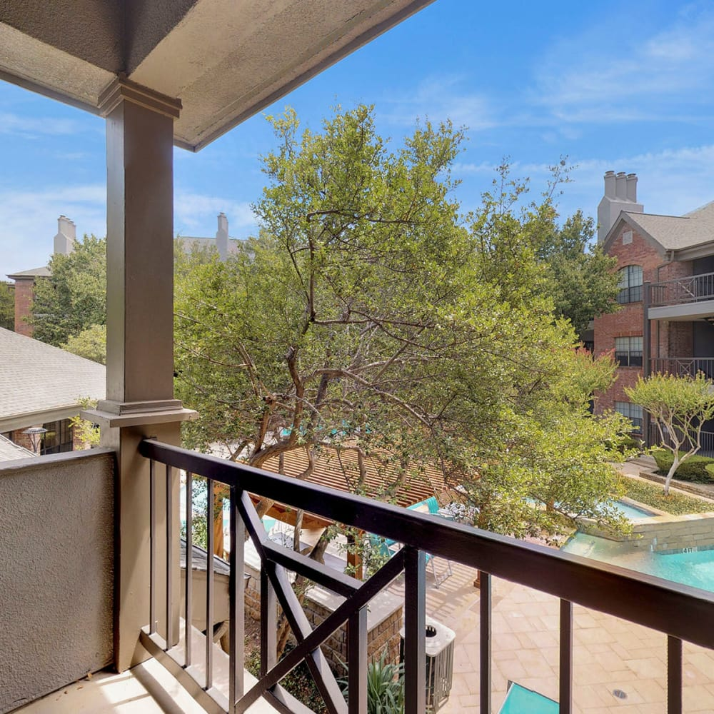 Private balcony overlooking the pool area outside a model home at Oaks Hackberry Creek in Las Colinas, Texas