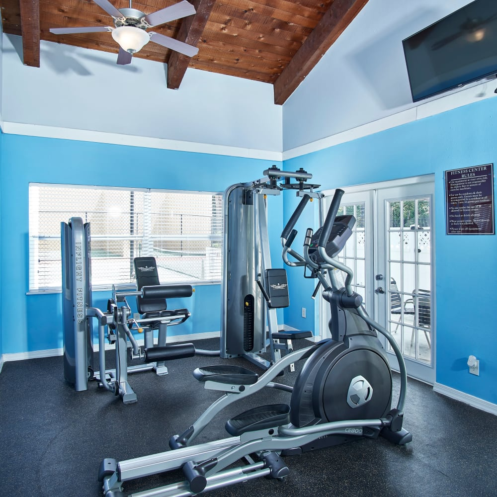 A fitness center with individual workout stations at Westwood @60 in Brandon, Florida