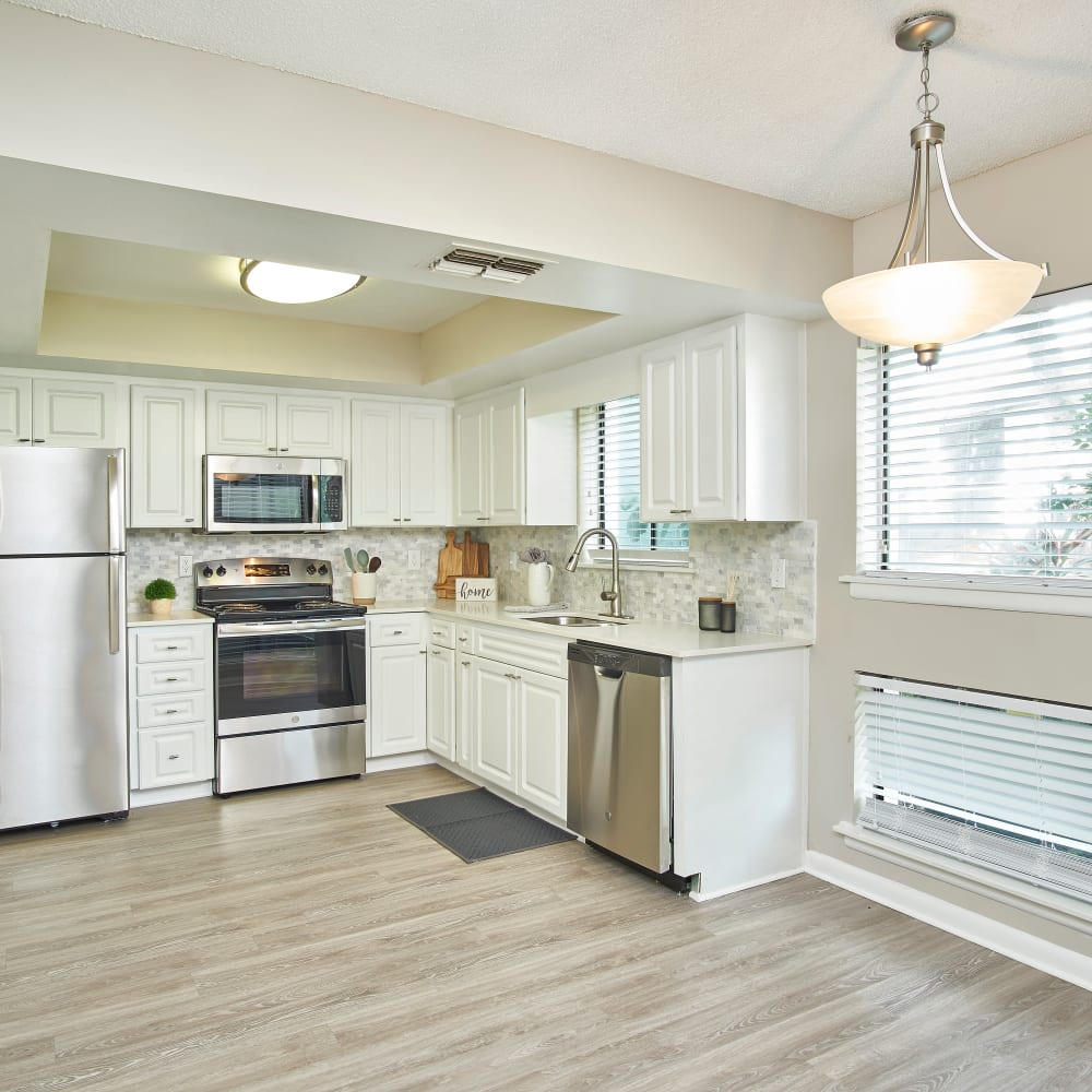 A kitchen with stainless-steel appliances at Westwood @60 in Brandon, Florida