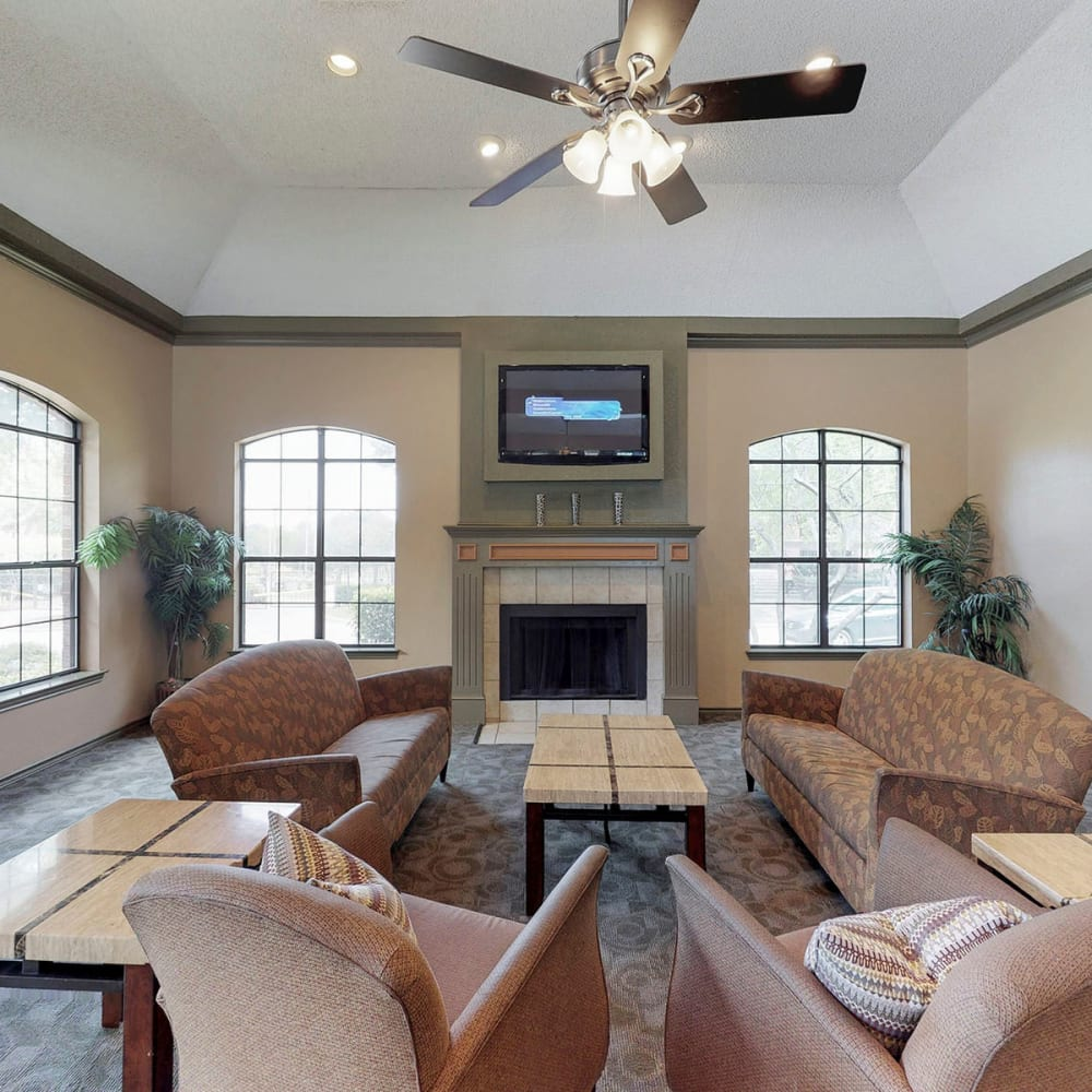Lounge seating in front of the fireplace in the clubhouse at Oaks Hackberry Creek in Las Colinas, Texas
