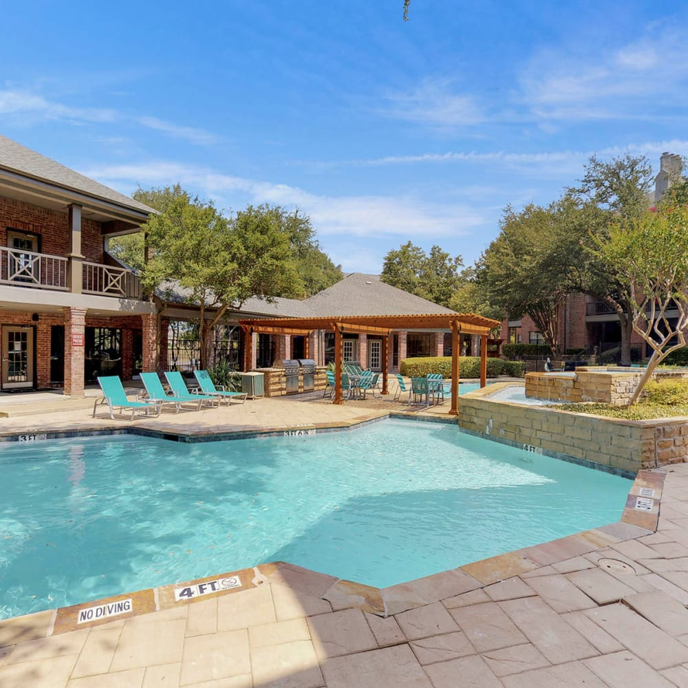 Beautiful day at the resort-style swimming pool at Oaks Hackberry Creek in Las Colinas, Texas