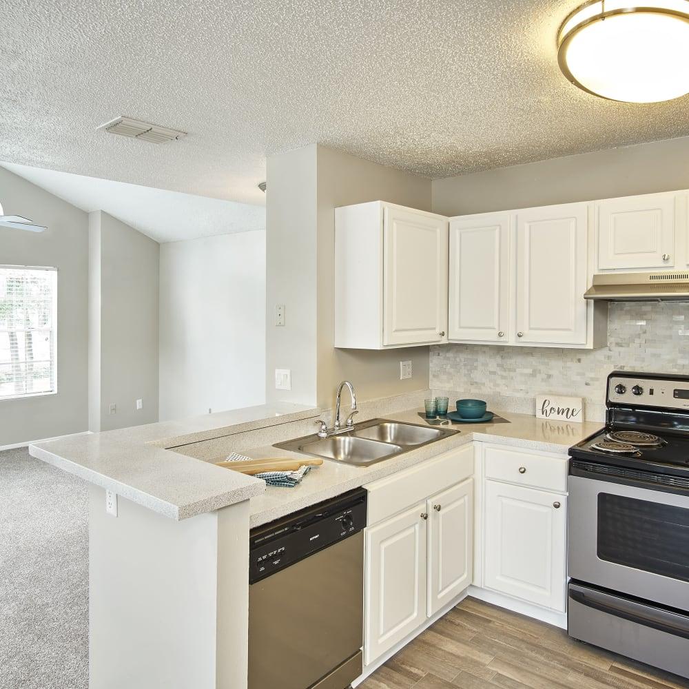 A kitchen with white cabinets at Avenue @Creekbridge in Brandon, Florida