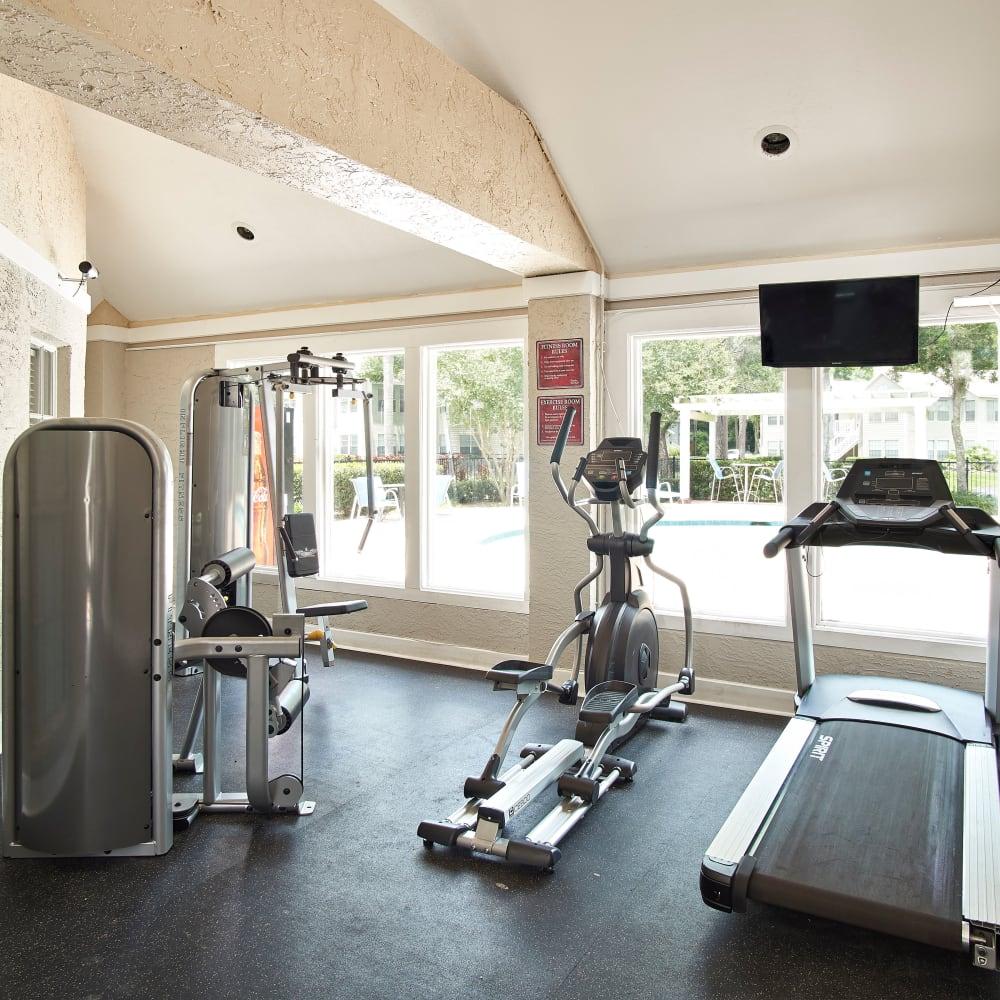 A fitness center with a treadmill at Avenue @Creekbridge in Brandon, Florida