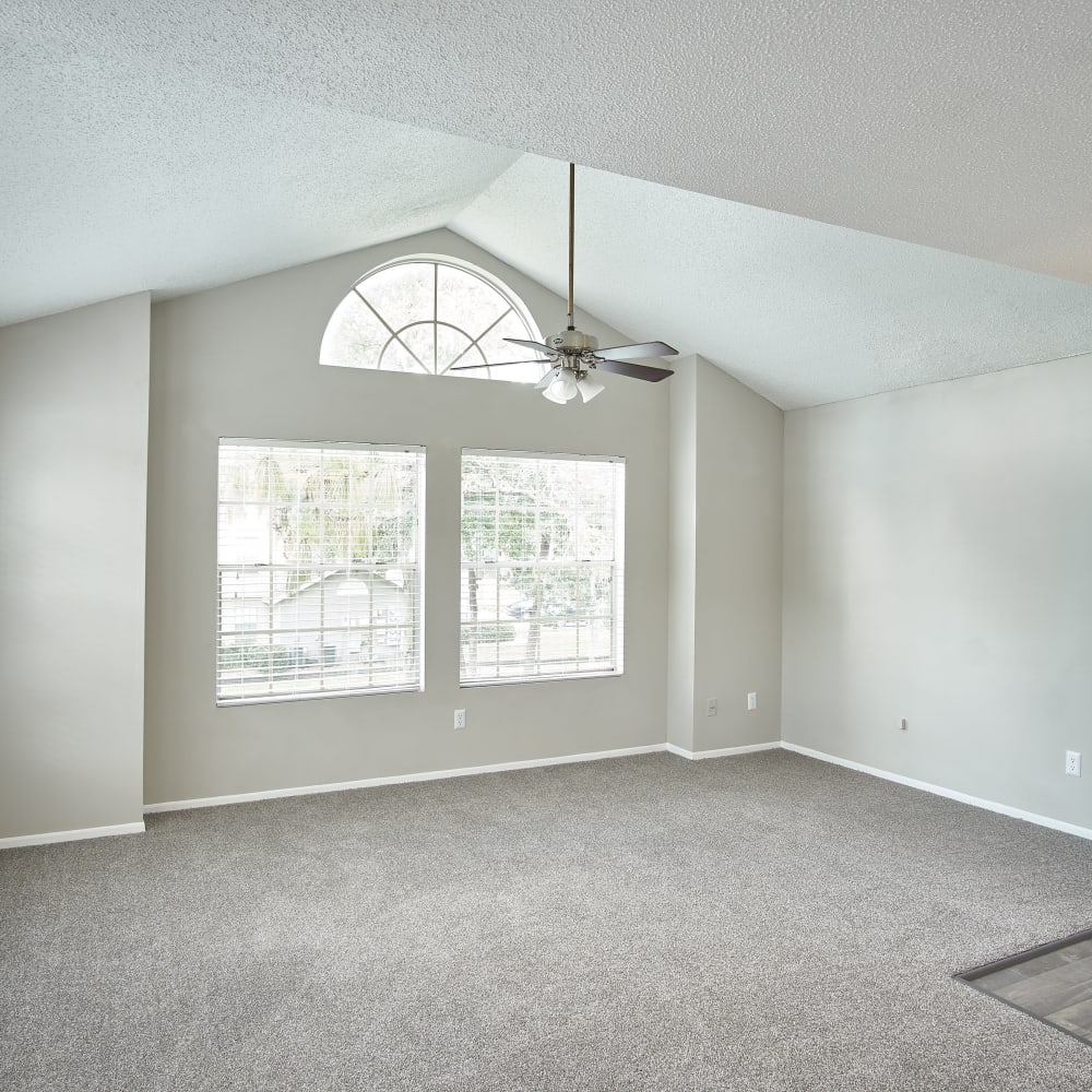 A large living room with lots of natural lighting at Avenue @Creekbridge in Brandon, Florida