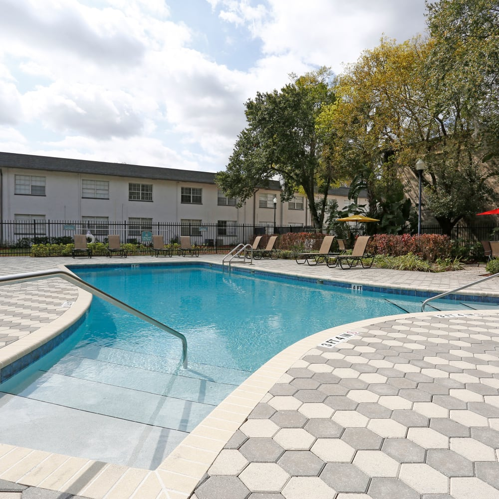 A swimming pool with a sundeck at Southern Cove Apartments in Temple Terrace, Florida