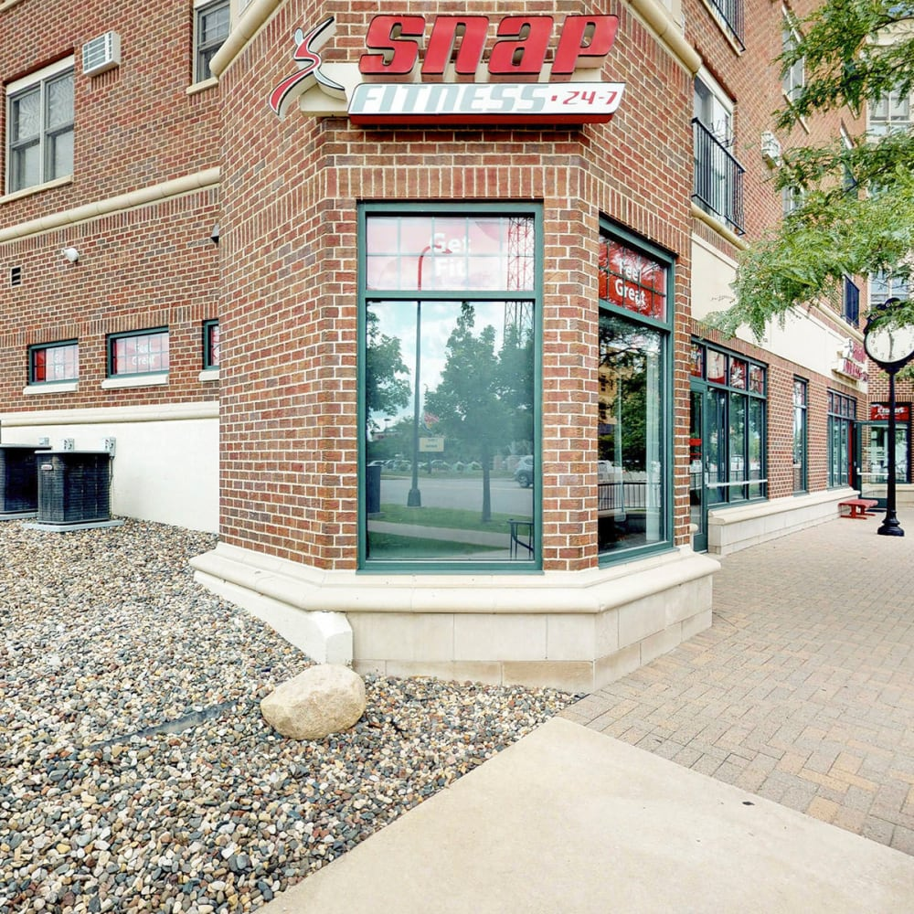 Exterior view of the SNAP Fitness location on the ground level of our building at Oaks Hiawatha Station in Minneapolis, Minnesota