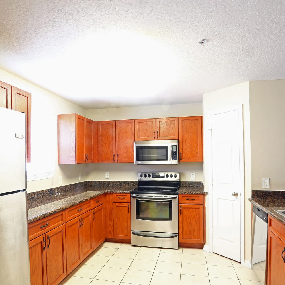 A large kitchen with plenty of cabinetry at Town Park Villas in Tampa, Florida