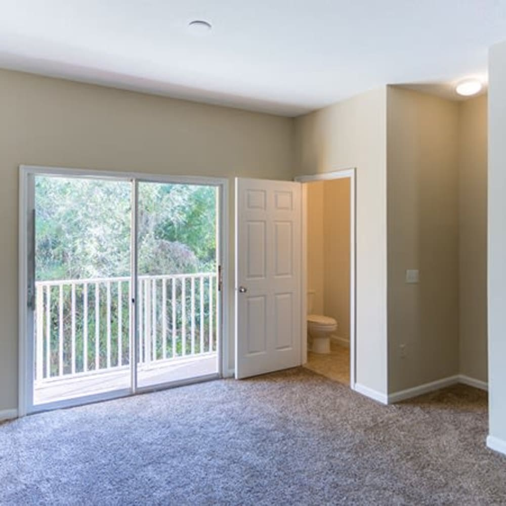 A living room with patio access at Town Park Villas in Tampa, Florida