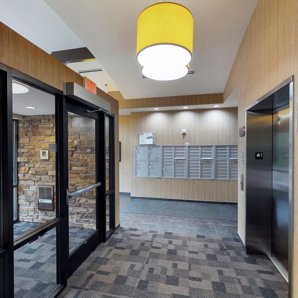 Interior entrance with mailboxes conveniently nearby at Oaks Glen Lake in Minnetonka, Minnesota