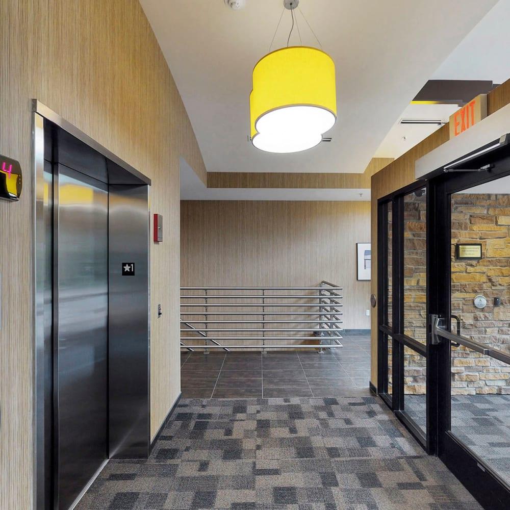 Elevator access to upper floors at Oaks Glen Lake in Minnetonka, Minnesota