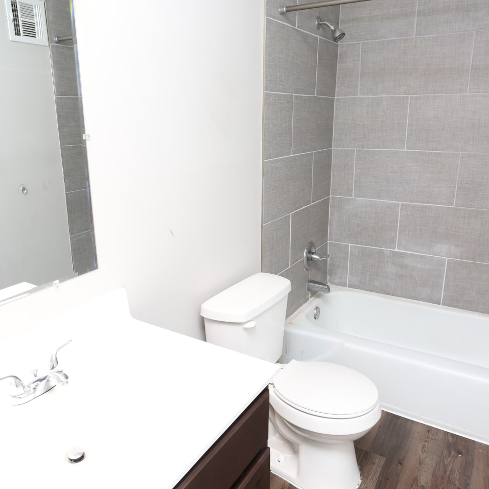 A bathroom with an oval tub and tiling at Reserve at Lindsay in Louisville, Kentucky