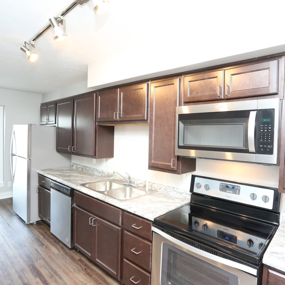 A kitchen with plenty of cabinetry at Reserve at Lindsay in Louisville, Kentucky