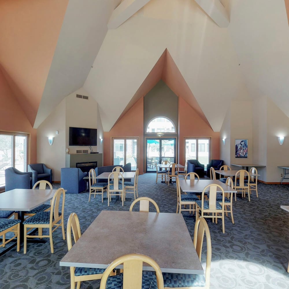 Ample seating areas in the clubhouse lounge at Oaks Lincoln Apartments & Townhomes in Edina, Minnesota