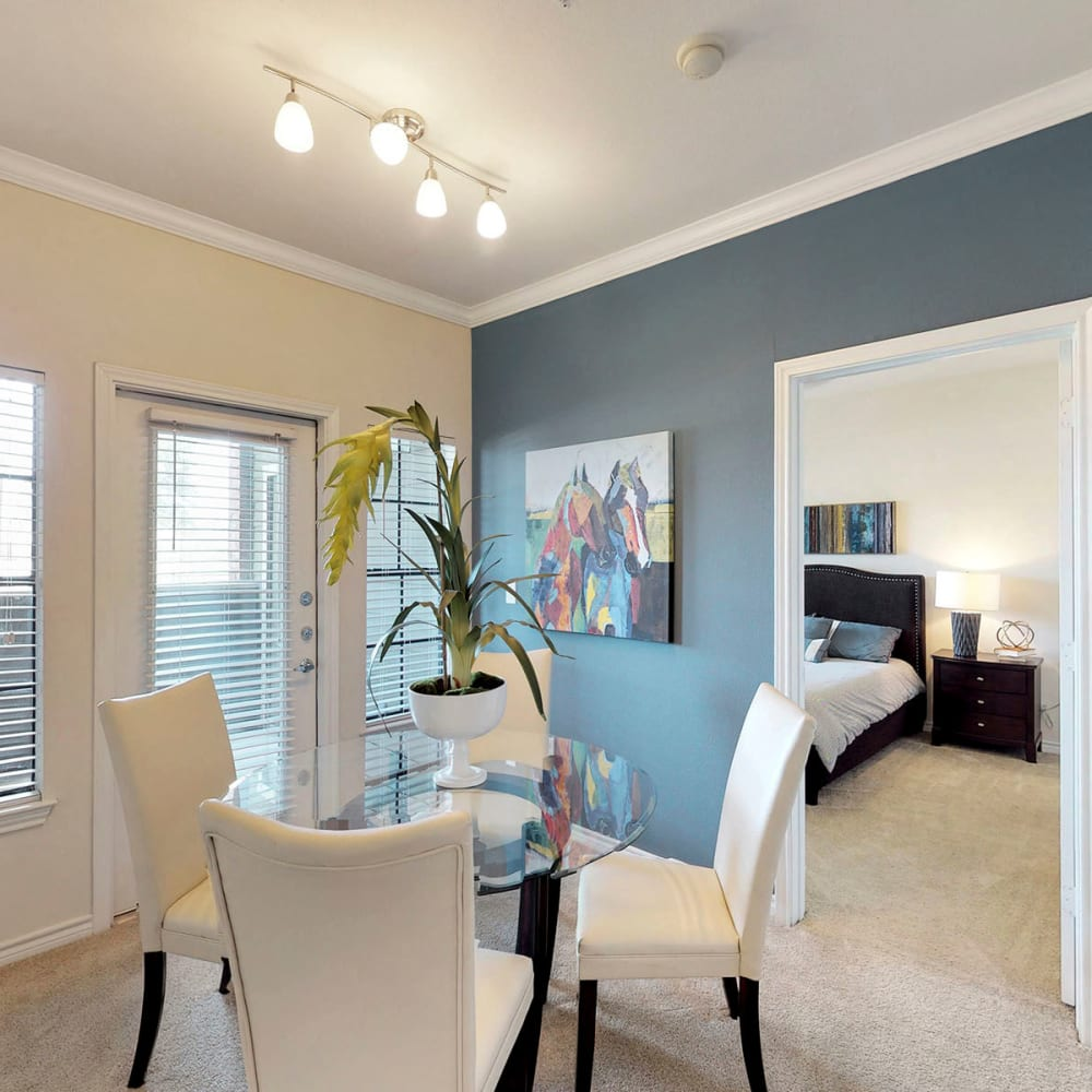Well-furnished dining area in a model home at Oaks Riverchase in Coppell, Texas