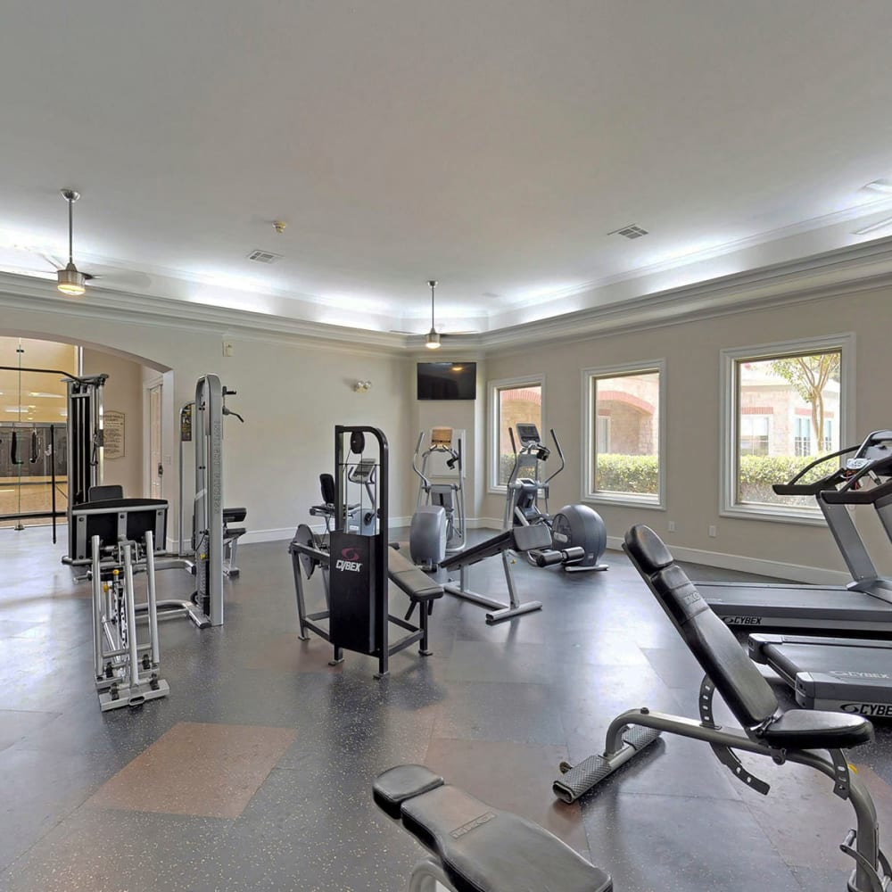 Exercise machines in the fitness center at Oaks Riverchase in Coppell, Texas