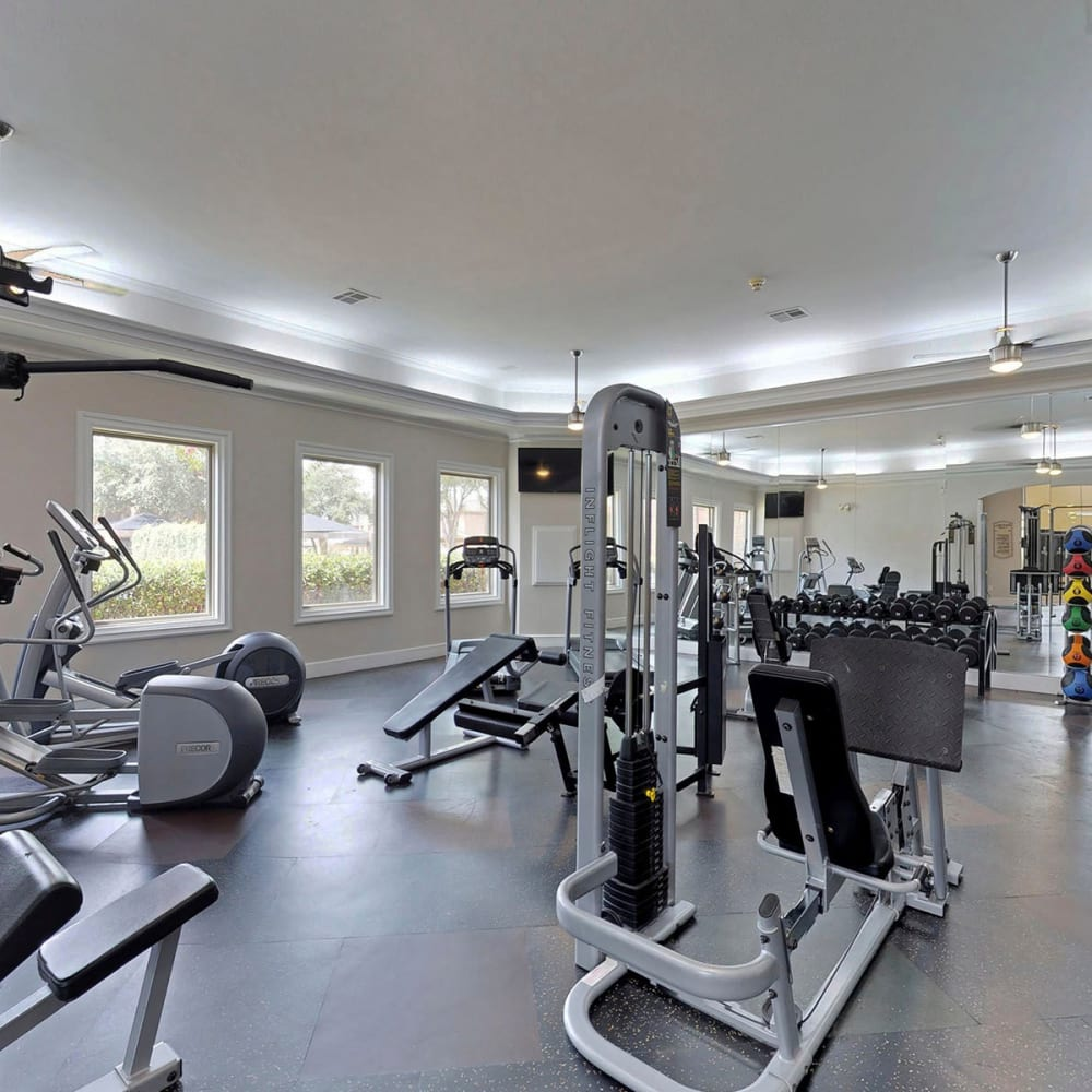 Cardio equipment and exercise stations in the onsite fitness center at Oaks Riverchase in Coppell, Texas