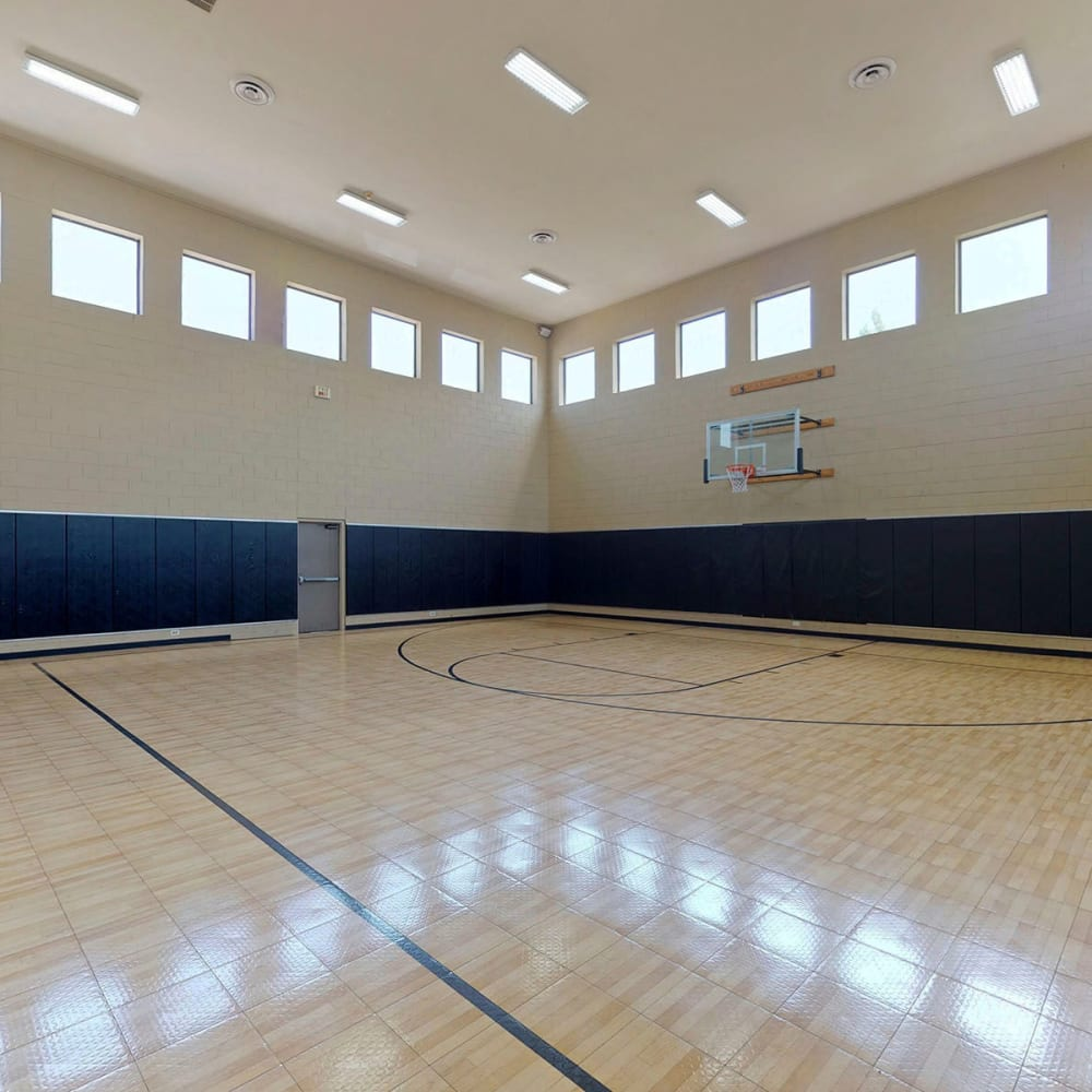 Indoor basketball court at Oaks Riverchase in Coppell, Texas