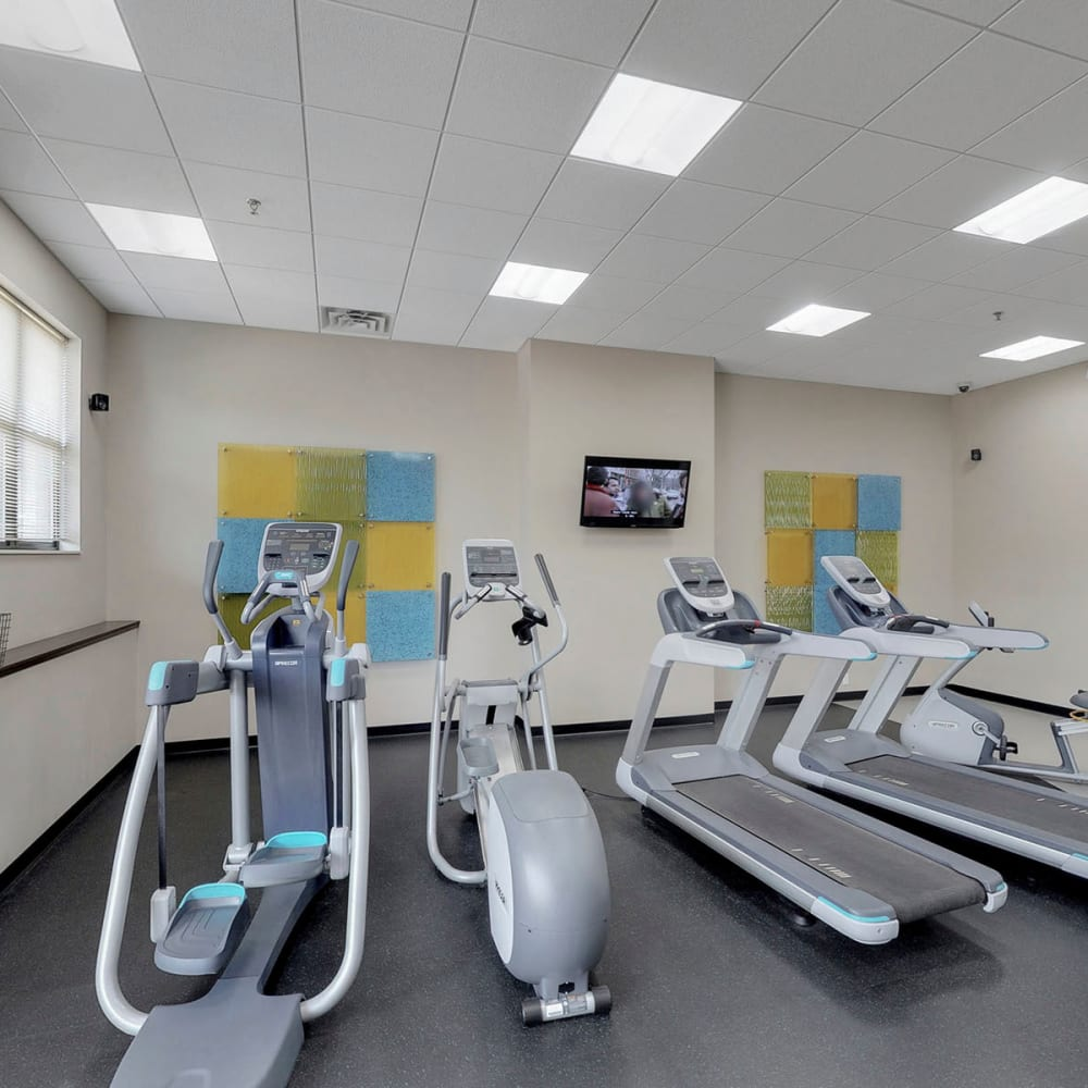 Treadmills and cardio machines in the onsite fitness center at Oaks Station Place in Minneapolis, Minnesota