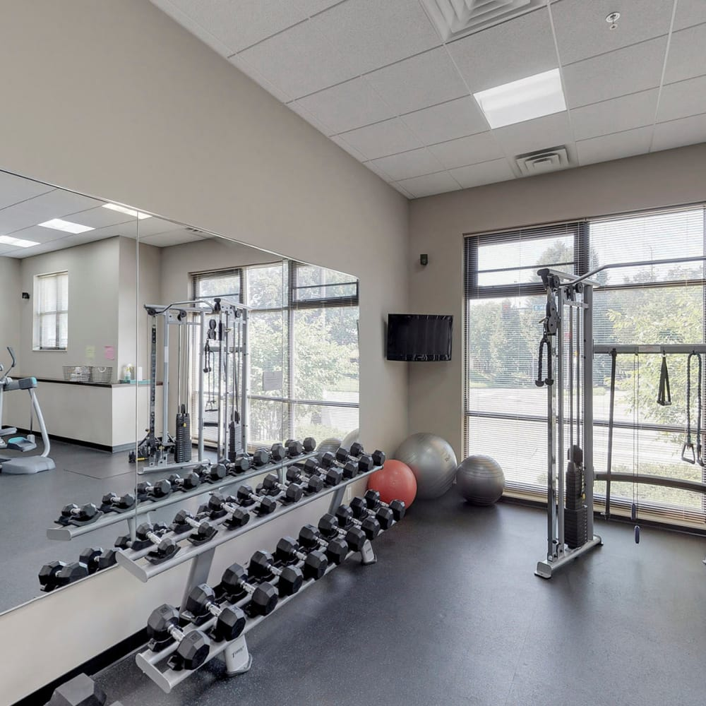 Free weights in the fitness center at Oaks Station Place in Minneapolis, Minnesota