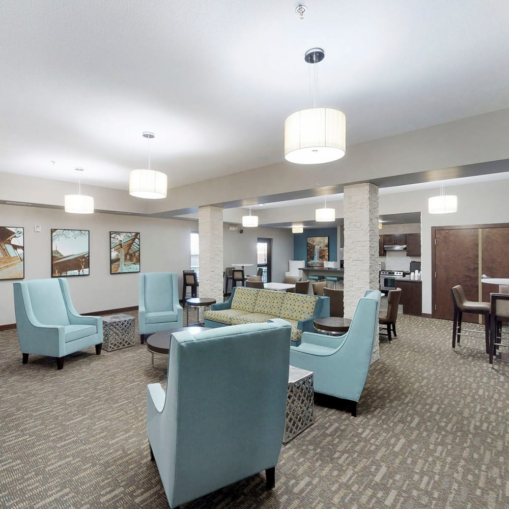 Bright and comfortably furnished lobby interior at Oaks Station Place in Minneapolis, Minnesota