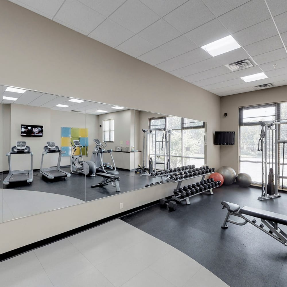 Well-equipped fitness center at Oaks Station Place in Minneapolis, Minnesota